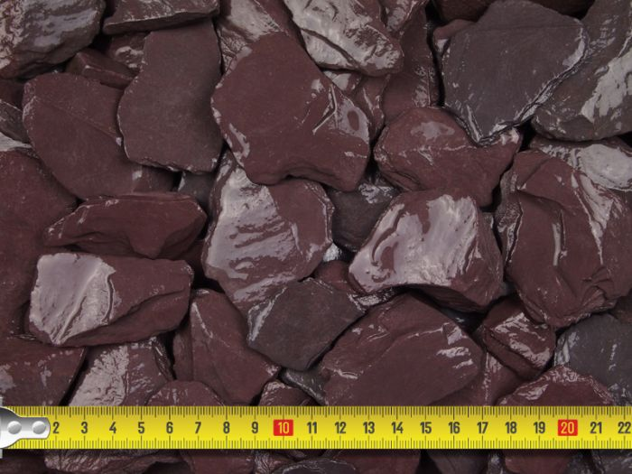 Close up of plum slate chips with a tape measure guide